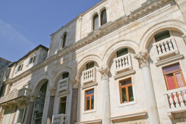 Photos of Split - Columns of the Peristyle and modern buildings